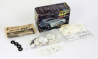 """BNPS.co.uk (01202 558833)<br /> Pic: BNPS<br /> <br /> Pictured: A James Bond Airfix 1966 Aston Martin DB-5 model<br /> <br /> An exact replica of the secret weapons case used by Sean Connery's 007 in From Russia With Love has emerged for sale for £14,000. <br /> <br /> The black attache case is one of only 100 models ever produced and has been described by experts as the """"holy grail"""" of James Bond memorabilia. <br /> <br /> The replica is to be sold alongside dozens of sought-after Bond items, including a set of 21 hand painted Corgi model figures, at Ewbank's Auctions of Woking, Surrey."""