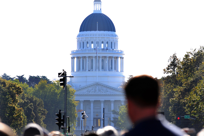 Onlookers enjoyed the spectacle of Space Shuttle Endeavors' flight over Capitol Mall in Sacramento, Friday, September 21, 2012. (photo by Pico van Houtryve)