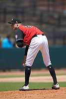 Hickory Crawdads relief pitcher Nick Snyder (25) looks to his catcher for the sign against the Charleston RiverDogs at L.P. Frans Stadium on May 13, 2019 in Hickory, North Carolina. The Crawdads defeated the RiverDogs 7-5. (Brian Westerholt/Four Seam Images)