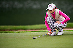 Yurong Chen of China lines up a putt during the Hyundai China Ladies Open 2014 on December 12 2014 at Mission Hills Shenzhen, in Shenzhen, China. Photo by Li Man Yuen / Power Sport Images
