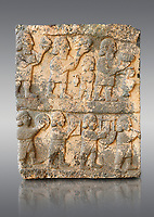 Pictures & images of the South Gate Hittite sculpture stele depicting Hittite Gods. 8th century BC. Karatepe Aslantas Open-Air Museum (Karatepe-Aslantaş Açık Hava Müzesi), Osmaniye Province, Turkey.   Against grey background