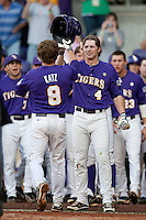 LSU Tigers outfielder Raph Rymes #4 greets teammate Mason Katz #8 following his first inning home run against the Mississippi State Bulldogs during the NCAA baseball game on March 17, 2012 at Alex Box Stadium in Baton Rouge, Louisiana. The 10th-ranked LSU Tigers beat #21 Mississippi State, 4-3. (Andrew Woolley / Four Seam Images).
