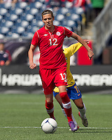 Two goal scorer, Canadian midfielder Christine Sinclair (12) at midfield. In an international friendly, Canada defeated Brasil, 2-1, at Gillette Stadium on March 24, 2012.