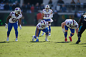 Buffalo Bills Ramon Humber (50), Jerry Hughes (55), Kyle Williams (95) line up on defense during an NFL Wild-Card football game against the Jacksonville Jaguars, Sunday, January 7, 2018, in Jacksonville, Fla.  (Mike Janes Photography)