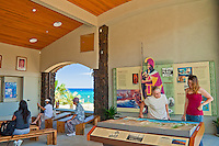 Visitors looking at artifacts and exhibitions at the Pu'ukohola Heiau National Historic Site visitor center, Kawaihae, Kohala, Big Island.