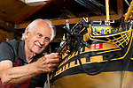 Pictured: Michael Byard works on his 1:48 scale replica of HMS Victory in his workshop in Abingdon, Oxfordshire.<br /> <br /> A retired sailor is finally completing his painstaking model of HMS Victory - 51 years after he started it.   Michael Byard first began work on the five feet long replica of Nelson's flagship in 1969.<br /> <br /> But after two years he was forced to put the 'labour of love' aside as he concentrated on his career and raising a family.   After it languished in his garage for almost four decades the pensioner finally decided to pick up his tools once again six years ago when he was 74.   SEE OUR COPY FOR DETAILS<br /> <br /> © Jordan Pettitt/Solent News & Photo Agency<br /> UK +44 (0) 2380 458800
