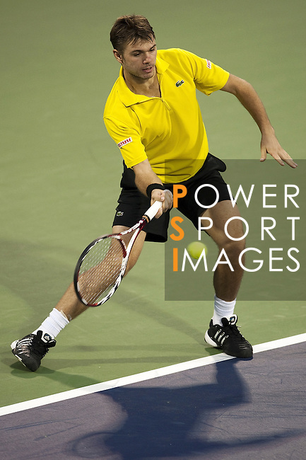 SHANGHAI, CHINA - OCTOBER 12:  Stanistas Wawrinka of Switzerland returns a shot to Lukasz Kubot of Poland during day two of 2009 Shanghai ATP Masters 1000 at the Qi Zhong Tennis Centre in Shanghai. Photo by Victor Fraile / The Power of Sport Images