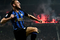 Stefan De Vrij of Internazionale celebrates after scoring second goal for his team as Milan fans light up smoke bombs during the Serie A 2018/2019 football match between AC Milan and FC Internazionale at stadio Giuseppe Meazza, Milano, March 17, 2019 <br /> Photo Andrea Staccioli / Insidefoto