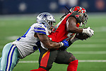 Dallas Cowboys and Tampa Bay players in action during the pre-season game between the Tampa Bay Buccaneers and the Dallas Cowboys at the AT & T Stadium in Arlington, Texas.