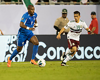 CHARLOTTE, NC - JUNE 23: Rodrigue Cesar #4 dribbles as Fernando Navarro #19 defends during a game between Mexico and Martinique at Bank of America Stadium on June 23, 2019 in Charlotte, North Carolina.