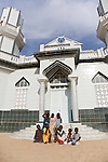 Children in Yoff pose in front of a roadside mosque in this primarily Muslim country.  Yoff is a fishing village approximately 30 minutes outside of Dakar, Senegal's capital city.