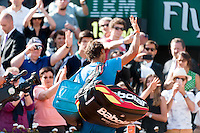 June 3, 2015: Rafael Nadal of Spain waves to the crowd after losing a Quarterfinal match against Novak Djokovic of Serbia on day eleven of the 2015 French Open tennis tournament at Roland Garros in Paris, France. Djokovic won 75 63 61. Sydney Low/AsteriskImages