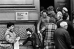 Derry, The Northern Bank Ltd. Lunch time, customers trying to get it the bank, for security reasons only a few are allowed in at a time . 1979.