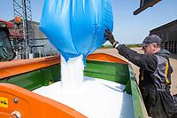 Loading fertilser spreader with prilled nitrogen - Norfolk, May