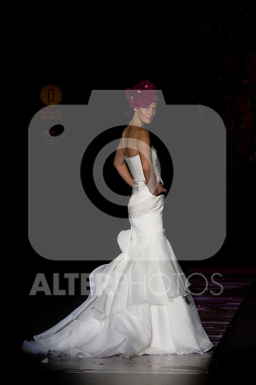 A model presents brides and party designs of Runway Miquel Suay at the Cibeles Madrid Novias in Ifema (Alterphotos/Marta Gonzalez)
