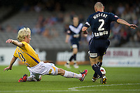 MELBOURNE, AUSTRALIA - NOVEMBER 06: Kevin Muscat of the Victory avoids a tackle from Bas van den Brink of Gold Coast United during the round 13 A-League match between the Melbourne Victory and Gold Coast United at Etihad Stadium on November 6, 2010 in Melbourne, Australia (Photo by Sydney Low / Asterisk Images)