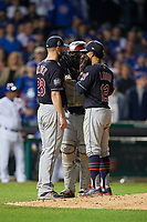 Cleveland Indians pitcher Corey Kluber (28) talks with Roberto Perez (55) and shortstop Francisco Lindor (12) in the sixth inning during Game 4 of the Major League Baseball World Series against the Chicago Cubs on October 29, 2016 at Wrigley Field in Chicago, Illinois.  (Mike Janes/Four Seam Images)