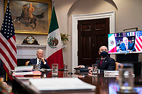 United States President Joe Biden and United States Secretary of Homeland Security Alejandro Mayorkas, listen during a virtual bilateral meeting with President Andrés Manuel López Obrador of Mexico in the Roosevelt Room of the White House in Washington on March 1st, 2021. <br /> Credit: Anna Moneymaker / Pool via CNP /MediaPunch