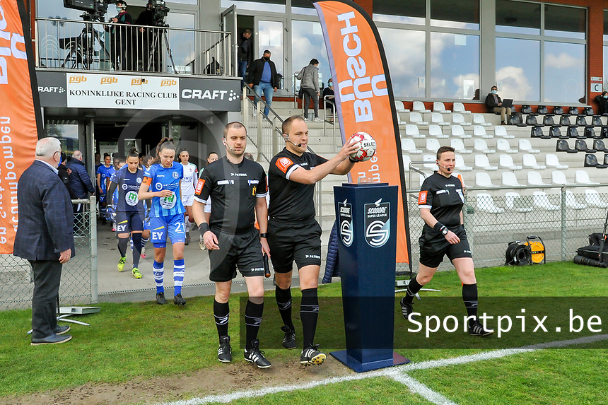 assistant referee Toon Bonduel , referee Florian Stove , assistant referee Ella De Vries pictured entering the field before a female soccer game between AA Gent Ladies and Oud Heverlee Leuven on the fourth matchday of play off 1 in the 2020 - 2021 season of Belgian Scooore Womens Super League , saturday 1 st of May 2021  in Oostakker , Belgium . PHOTO SPORTPIX.BE | SPP | STIJN AUDOOREN