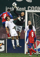 Jonathan Bornstein #12 of the USA is beaten to a high ball by Alvoro Saborio #9 and Keilor Navas #1 of Costa Rica during a 2010 World Cup qualifying match in the CONCACAF region at RFK Stadium on October 14 2009, in Washington D.C.The match ended in a 2-2 tie.