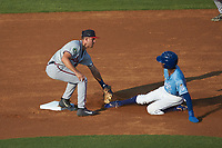 Danville Braves shortstop Beau Philip (4) applies a tag to Maikel Garcia (2) of the Burlington Royals as he attempts to steal second base at Burlington Athletic Stadium on August 9, 2019 in Burlington, North Carolina. The Royals defeated the Braves 6-0. (Brian Westerholt/Four Seam Images)