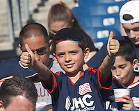 New England Revolution fan. In a Major League Soccer (MLS) match, the New England Revolution (blue/white) defeated Houston Dynamo (orange), 2-0, at Gillette Stadium on April 12, 2014.