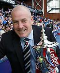 Mark Warburton safeguards the league trophy