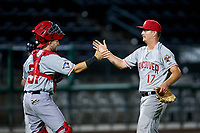 Vancouver Canadians catcher Philip Clarke (31) and relief pitcher Luke Gillingham (17) congratulate one another after a victory in a Northwest League game against the Tri-City Dust Devils at Gesa Stadium on August 21, 2019 in Pasco, Washington. Vancouver defeated Tri-City 1-0. (Zachary Lucy/Four Seam Images)
