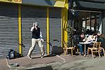 Hackney, Chatsworth Road, Man doing street dance, people enjoying Sunday morning coffee. London Uk 2012, 2010s
