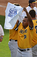 Devin Ruiz of the UNC Greensboro Spartans holds up a championship T-shirt after the team won the Southern Conference Championship on Sunday, May 28, 2017, at Fluor Field at the West End in Greenville, South Carolina, by beating the Furman Paladins 13-1. (Tom Priddy/Four Seam Images)