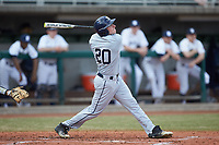 Blaine Griffiths (20) of the Xavier Musketeers follows through on his swing against the Penn State Nittany Lions at Coleman Field at the USA Baseball National Training Center on February 25, 2017 in Cary, North Carolina. The Musketeers defeated the Nittany Lions 10-4 in game one of a double header. (Brian Westerholt/Four Seam Images)