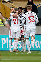 23rd May 2021; Molineux Stadium, Wolverhampton, West Midlands, England; English Premier League Football, Wolverhampton Wanderers versus Manchester United; Manchester United players celebrate with goal scorer Anthony Elanga to take the lead 1-0 in the 13th minute