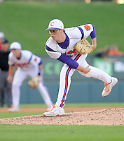 Relief pitcher Clay Bates (42) of the Clemson Tigers in a game against the Elon College Phoenix on March 21, 2012, at Fluor Field at the West End in Greenville, South Carolina. Clemson won 4-2, giving head coach Jack Leggett his 1,200th win. (Tom Priddy/Four Seam Images)