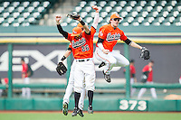 Luke Plucheck #26, Travis Lee #5 and Colt Atwood (rear) celebrate their win over the Texas Tech Red Raiders at Minute Maid Park on March 1, 2014 in Houston, Texas.  The Bearkats defeated the Red Raiders 10-6.  (Brian Westerholt/Four Seam Images)