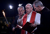 Pope Francis holds the wooden cross during the Via Crucis (Way of the Cross) torchlight procession on Good Friday in front of the Colosseum in Rome.March 30, 2018