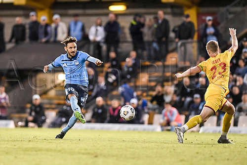 18th April 2021; Leichardt Oval, Sydney, New South Wales, Australia; A League Football, Sydney Football Club versus Adelaide United; Milos Ninkovic of Sydney takes a shot on goal as Jordan Elsey of Adelaide United attempts to block