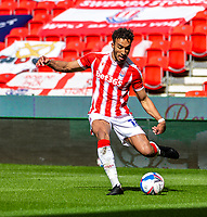 5th April 2021; Bet365 Stadium, Stoke, Staffordshire, England; English Football League Championship Football, Stoke City versus Millwall; Jacob Brown of Stoke City crosses the ball into the Millwall area