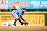 Tampa Bay Rays shortstop Willy Adames (27) fields a ground ball during a Spring Training game against the Pittsburgh Pirates on March 10, 2017 at LECOM Park in Bradenton, Florida.  Pittsburgh defeated New York 4-1.  (Mike Janes/Four Seam Images)