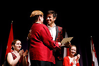 Stage IV finalist Valerio Lisci from Italy receives the Margaret Louise Smith and Nancy Smith Taylor Memorial Prize for best performance of the 6th Composition Contest winner's work during the awards ceremony of the 11th USA International Harp Competition at Indiana University in Bloomington, Indiana on Saturday, July 13, 2019. (Photo by James Brosher)