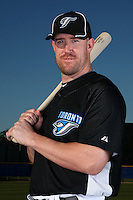 March 1, 2010:  Catcher John Buck (14) of the Toronto Blue Jays poses for a photo during media day at Englebert Complex in Dunedin, FL.  Photo By Mike Janes/Four Seam Images