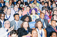 People listen as the Democratic nominee for president Tim Kaine speaks at the Democratic National Convention at the Wells Fargo Center in Philadelphia, Pennsylvania, on Wed., July 27, 2016.
