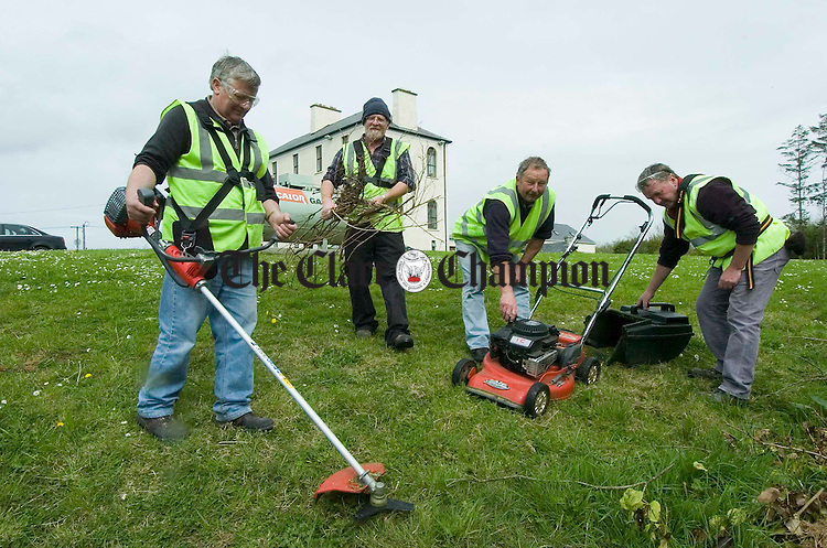 Sean Cusack, Gerard O Loughlin, Pat Donoghue and Michael Danaher at work on the grounds of the Stella Maris in Lisdoonvarna. Photograph by John Kelly.