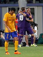 Calcio: amichevole Fiorentina vs Barcellona. Firenze, stadio Artemio Franchi, 2 agosto 2015.<br /> Fiorentina's Federico Bernardeschi, center, celebrates with teammate Fiorentina's Josip Ilicic after scoring his second goal as FC Barcelona's Pedro Rodriguez, left, reacts during the friendly match between Fiorentina and FC Barcelona at Florence's Artemio Franchi stadium, 2 August 2015.<br /> UPDATE IMAGES PRESS/Riccardo De Luca
