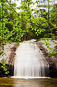 The Bearcamp River spills over ledge forming Beede Falls, a great summer swimming hole in Sandwich, New Hampshire.