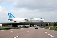 Cargo Aircraft  Antonov AN124 crossing at taxiway bridge Autobahn A14 near Leipzig. .. (Photo.:Nobel-Heise)....Cargo, Autobahn, freeway, bridge, shipping, porterage,carring, Antonov, Taxiway, Havy Traffic, Pilot, Cockpit, Leitwerk, empennage, engine, Traffic, Luftverkehr, Aviation,