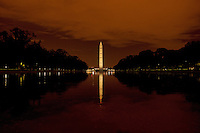 Night photograph of the Washington Monument in Washington DC. Reflected in the pool.