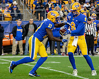 Pitt quarterback Kenny Pickett hands off to Pitt running back AJ Davis (21). The Boston College Eagles defeated the Pitt Panthers 26-19 in the football game played at Heinz Field, Pittsburgh Pennsylvania on November 30, 2019.
