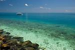 Dive boat at rest on beautiful lagoon, Layang Layang atoll, Sabah, Malaysia, South China Sea, Pacific Ocean