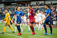 TACOMA, WA - JULY 31: Lauren Barnes #3 and Sarah Bouhaddi #12 of the OL Reign enter the pitch before a game between Racing Louisville FC and OL Reign at Cheney Stadium on July 31, 2021 in Tacoma, Washington.