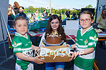 Aoife and Aine Scanlon with the winner Grace Healy centre at the Legion GAA bake off on Saturday